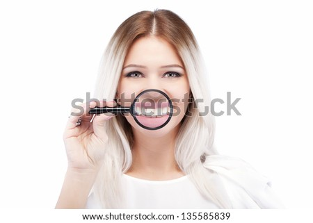 attractive caucasian girl with loupe on her shiny white teeth