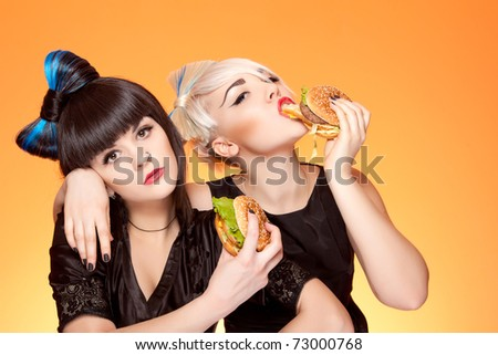 attractive caucasian girls with unhealthy food - stock photo
