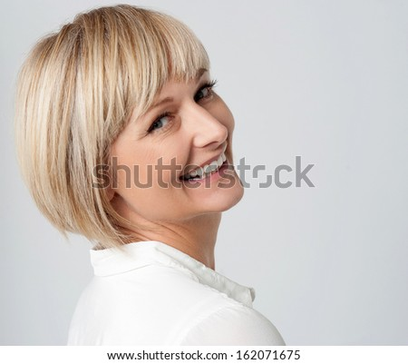 Attractive caucasian lady filled with joy - stock photo