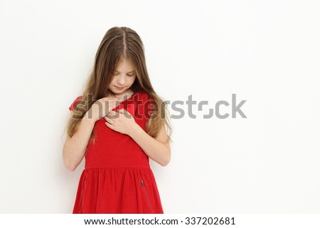 Attractive caucasian little girl with heart symbol - stock photo