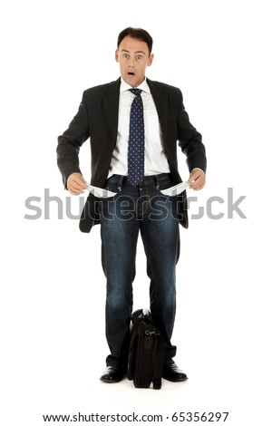 Attractive caucasian middle aged businessman turning his own empty pockets inside out. Studio shot. White background