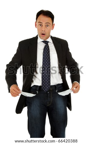 Attractive caucasian middle aged businessman turning his own empty pockets inside out. Studio shot. White background - stock photo