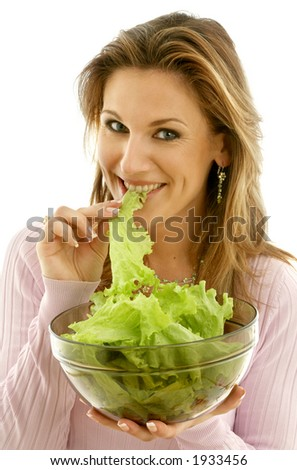 attractive caucasian woman eating lettuce - stock photo