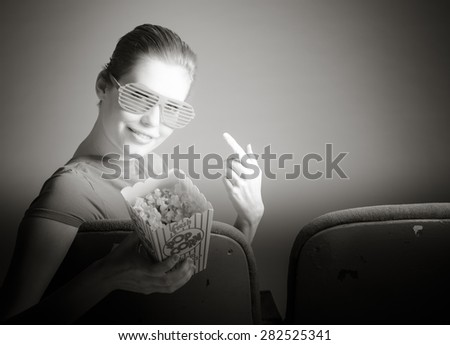 Attractive caucasian woman in the theatre in her 30 isolated on a grey background, black and white image - stock photo