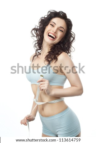attractive caucasian woman measuring her weist isolated on white background smiling - stock photo
