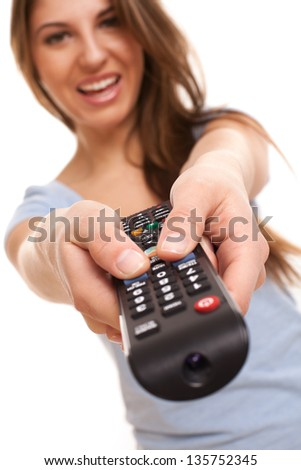 Attractive caucasian woman with  TV remote in her hand - stock photo