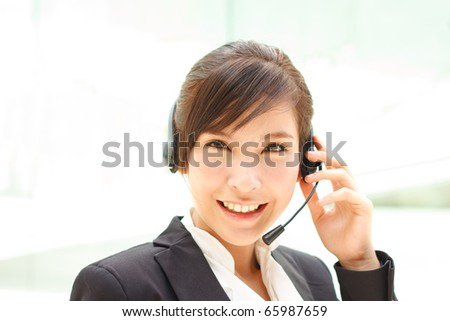 Attractive cheerful asian operator - stock photo