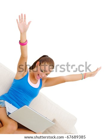 attractive cheerful young girl with laptop working on couch isolated on white - stock photo