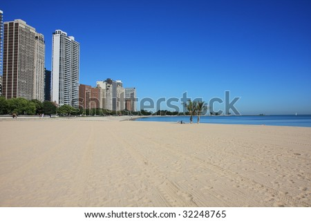 Attractive Chicago beach right on Lake Michigan, Oak Street Beach in the Gold Coast. - stock photo
