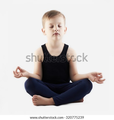 attractive child practicing yoga isolated on white background. little Boy does yoga - stock photo