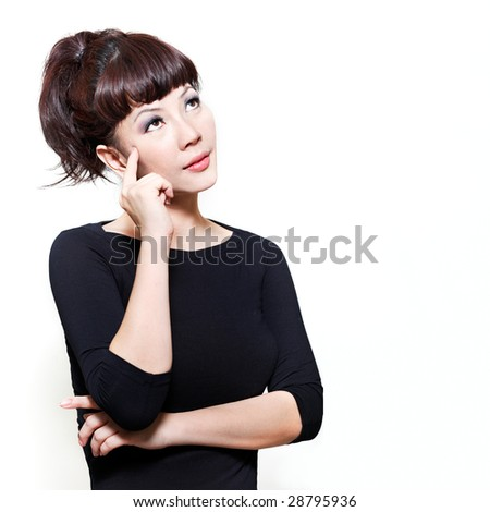 Attractive chinese young woman with a contemplative expression looking away. - stock photo