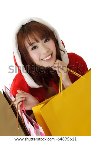 Attractive Christmas girl shopping and holding bags. - stock photo