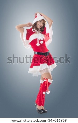 Attractive Christmas lady of Asian woman, full length portrait. - stock photo