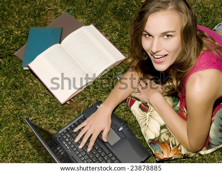 Attractive College Student Studying Outdoors. - stock photo