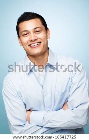 attractive confident young man smiling blue background - stock photo