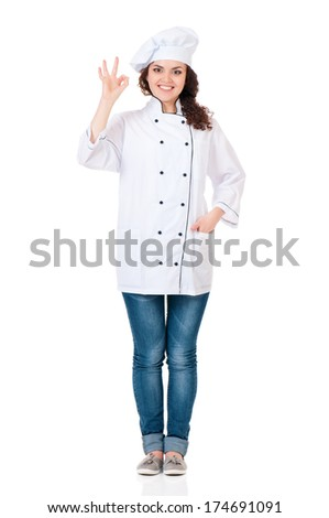 Attractive cook young woman showing ok on white background  - stock photo