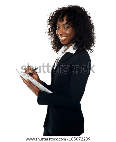Attractive corporate lady preparing annual reports. Facing camera