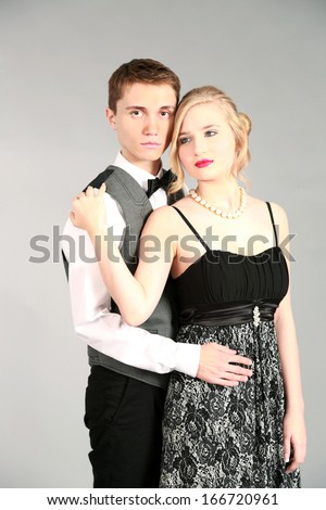attractive couple dressed up going to a dance or wedding - stock photo