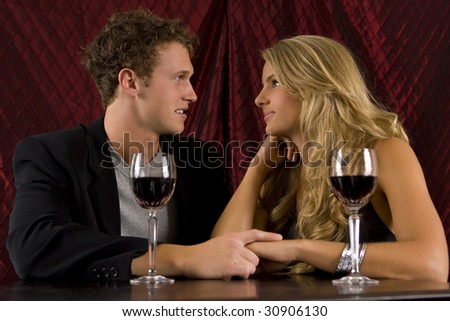 Attractive couple drinking wine together
