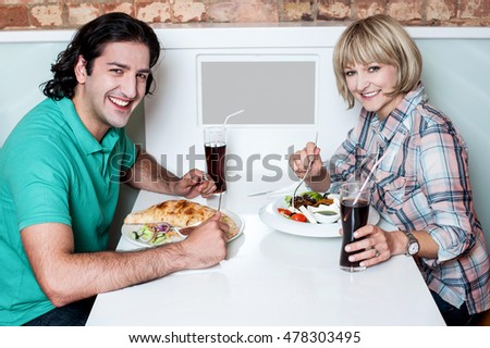 Attractive couple having dinner together at a restaurant