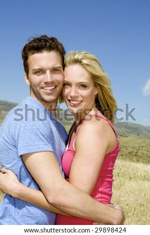 Attractive couple in a grassy meadow