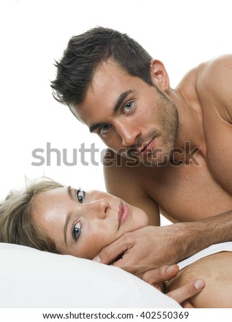 attractive couple in love under white bed sheets - stock photo