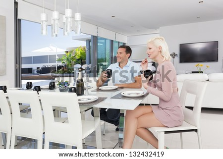 Attractive couple in luxury apartment - stock photo