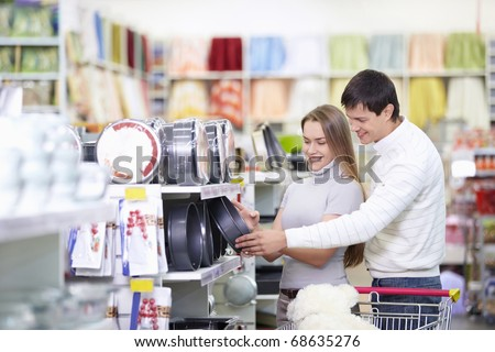 Attractive couple in the store - stock photo