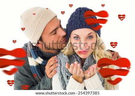 Attractive couple in winter fashion against hearts - stock photo