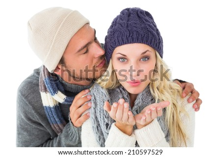 Attractive couple in winter fashion on white background - stock photo