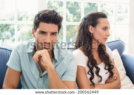 Attractive couple not talking on the couch at home in living room - stock photo