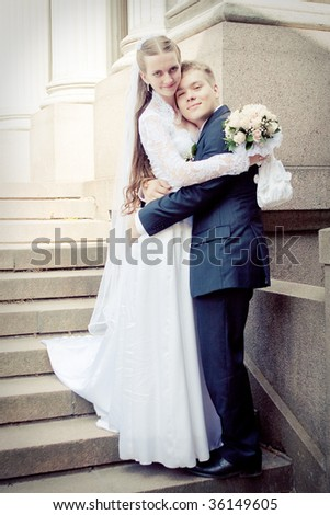 Attractive couple on their wedding day - stock photo