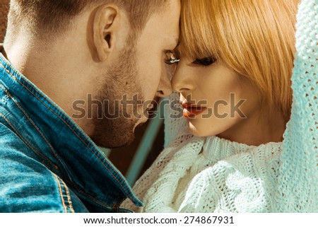 Attractive couple seduce each others outdoors - stock photo