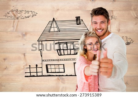 Attractive couple showing thumbs up to camera against bleached wooden planks background - stock photo