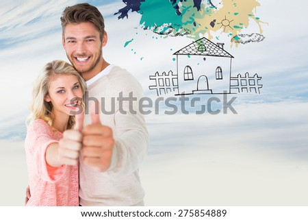 Attractive couple showing thumbs up to camera against blue sky with clouds - stock photo
