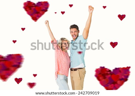 Attractive couple smiling and cheering against hearts - stock photo