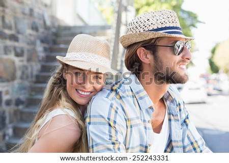 Attractive couple spending time together on a sunny day in the city - stock photo