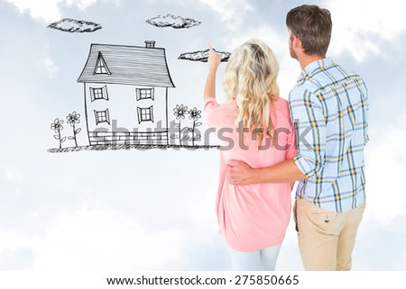Attractive couple standing and looking against blue sky - stock photo