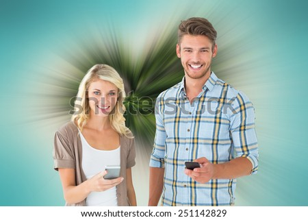 Attractive couple using their smartphones against tropical island in heart shape - stock photo