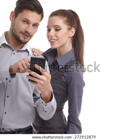 Attractive couple using their smartphones on white background