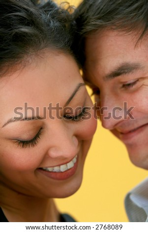 attractive couple with yellow background - stock photo
