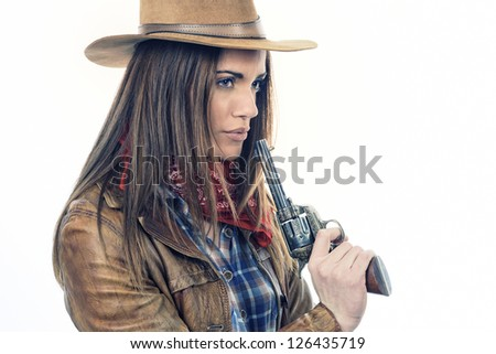 Attractive cowgirl on white background - stock photo