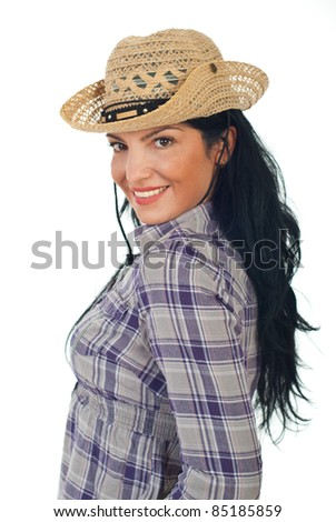 Attractive cowgirl  with hat standing in profile and looking to camera isolated on white background