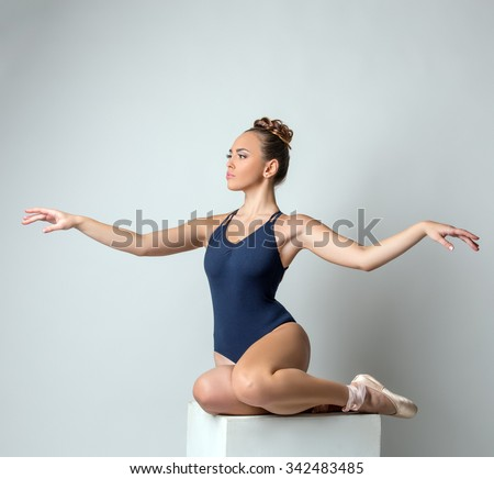 Attractive dancer posing gracefully waving hands - stock photo