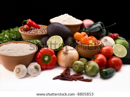 attractive display of all of the fresh ingredients, peppers, onions ...