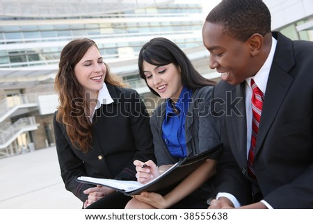 Attractive diverse business man and women team at office building - stock photo