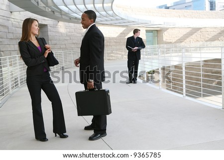 Attractive diverse business people at their company - stock photo