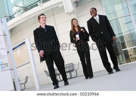 Attractive diverse business team at their company