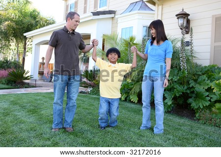 Attractive diverse family outside their home on porch - stock photo