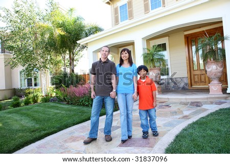 Attractive diverse happy family outside their home - stock photo